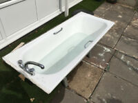 White bathtub with steel support bars