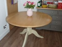 round natural oak dining table