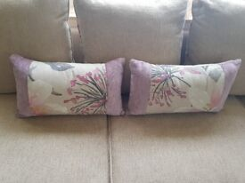 2 cushions with matching bed runners