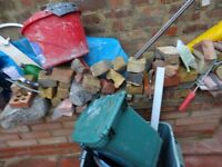 Hard core broken bricks , some broken or cut slab sand some timber buyer collect n22 7tw