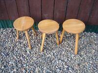 three small pine stools