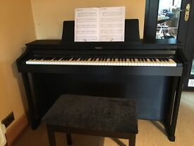 Roland Electric Piano in excellent condition. As new including stool, selling as we are moving house