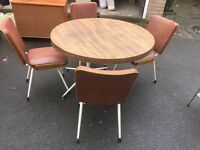 Solid wood round dining table plus 4 matching chairs