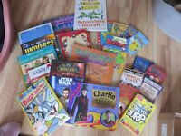 Selection of children's books for various ages.