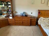 Bedroom furniture: dresser, drawers, display cabinet.