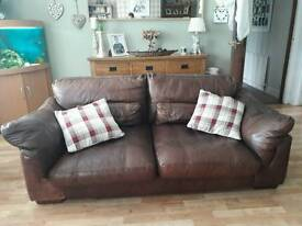 Large brown leather suite