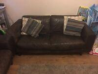 Two brown leather habitat sofas