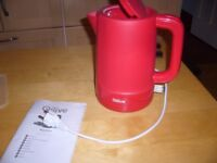 Nice red kettle, European plug, would suit continental Campervan