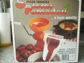Tomato press - genuine Italian gadget for processing fresh tomatoes