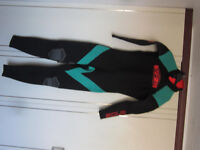 Four adult wet suits, previously loved, in good condition.
