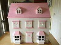 Wooden Dolls House with family and furniture.