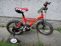 Raleigh Mini red bike with stabilisers and a bell, suit age 3 to 5 years, 14 inch wheels