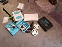 Black nintendo WII with loads of accessories