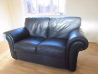 TWO SEATER BLACK LEATHER SOFA GOOD CLEAN CONDITION
