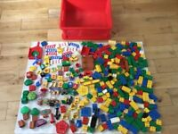 Duplo (by Lego). Huge box of Duplo including figures, Winnie the Pooh characters, trees, trains, etc