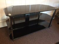 TV STAND BLACK GLASS, SCRATCH LESS GLASS CLEAN CONDITION, SIZE Width 105cm, Deep 45cm, Height 54cm.