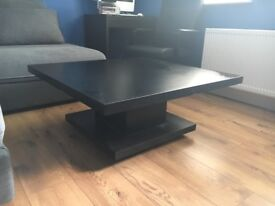 Black wooden coffee table and large tv stand