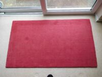 Rug with 100% wool pile, crimson in colour