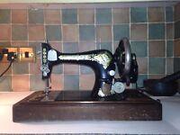 Antique Singer sewing machine with original wooden case