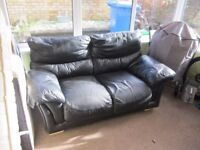 2 black leather sofas - 1 two seater, 1 three seater