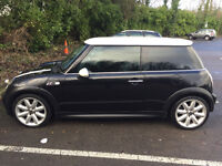 Mini Cooper 1.6 16v Black with 57,520 miles on the clock.