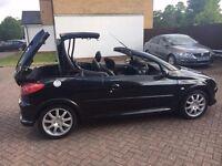 Black Peugeot 206 convertible automatic 1.6 petrol 06 reg: low mileage