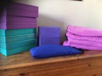 Yoga blocks, bricks and blankets.