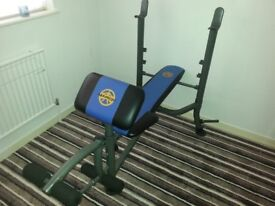 Marcy weight bench and weights for sale.