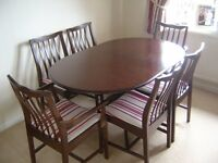 Stag Minstrel Extendable dining room table and 6 chairs.