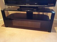 Sturdy Black TV Stand Unit with Dark Glass Top plus Shelf Storage and Hinge-down Lower Section