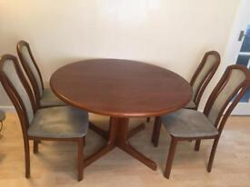 Extending solid wood dining table with 4 chairs