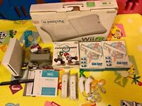 Wii Bundle( Wii console, Guns, Wheel, Fit board, Games)