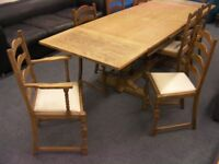 Antique Wooden Dining Table with 8 Matching Chairs - Extends to seat 10