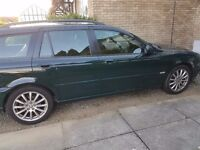 Jaguar Estate 2.5 Awd green with a charcoal half leather interior. Engine has a coolant leak