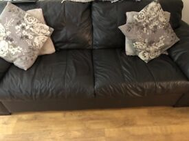 Brown leather four seater sofa