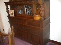 Old Charm court cupboard. Medium oak.