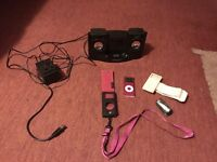 Pink 4GB iPod Nano with speakers and accessories