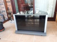 Corner TV Stand with black glass top.
