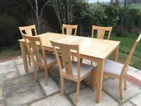 Table and chairs extending dining table plus six chairs