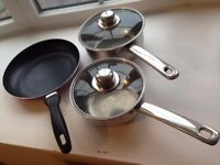 Set of 2 stainless steel pans small & medium size, also a none stick frying pan