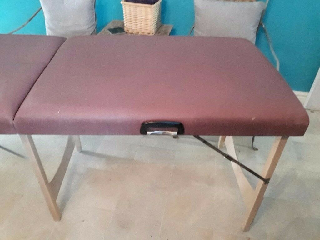 Therapy table with carrying case.