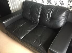 DFS Black Leather 2 Seater Sofa & Storage Footstool