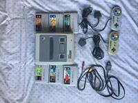 Super nintendo complete with 6 games And 2 controllers