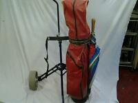 golf bag and trolley and golf clubs and Woods +balls