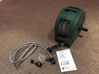 Brand new 25m enclosed garden hose reel inc adapters