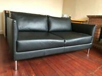 2 leather sofas with covers
