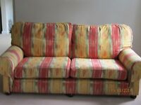 Large sofa covered in Sanderson fabric. Comfortable and stylish