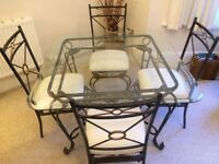 Dining room table/chairs wrought iron with glass top & matching coffee table