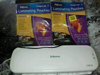 Fellowes Laminator with 2 packs of laminating pouches
