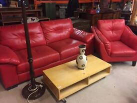 Red leather sofa and arm chair